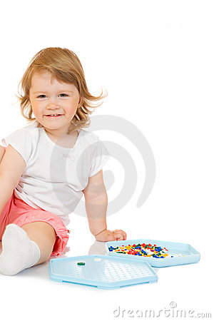 Small girl with toy mosaic