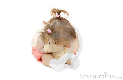 Small girl with toy bear