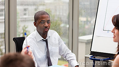 Afro-American businessman interacting with his tea