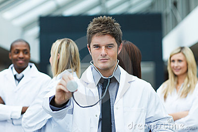 Handsome doctor with stethoscope