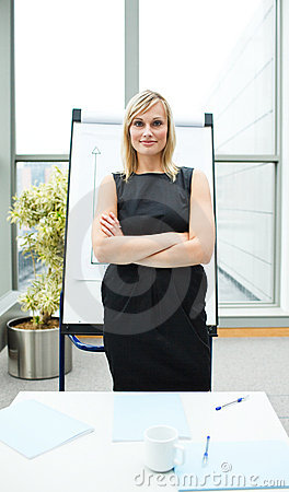 Confident isolated businesswoman in office