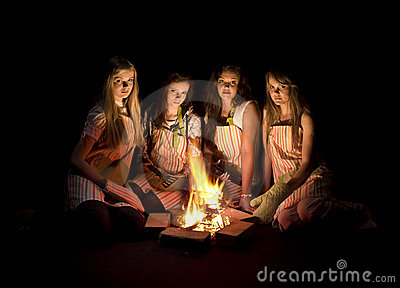 Teens around campfire