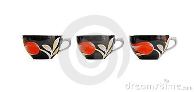 Row of three black tea cups isolated