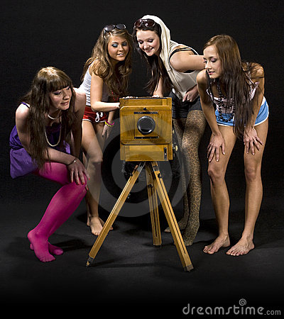 Girls admiring antique camera