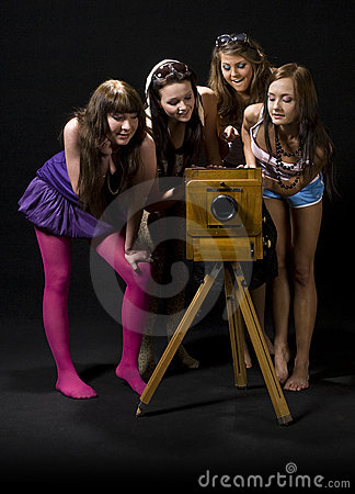 Teen girls and antique camera