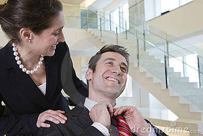 Business colleague getting congratulated.