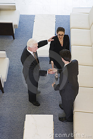 Elevated view of businesspeople shaking hands.