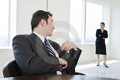 Two business colleagues in a meeting.