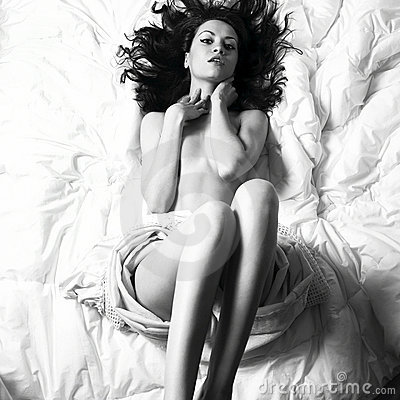 Young seductive woman in bed