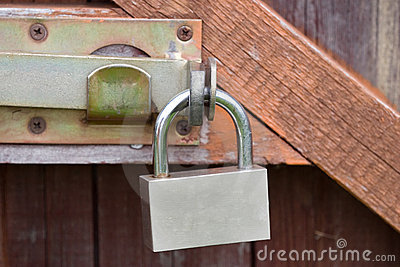 Padlock on an old wooden door