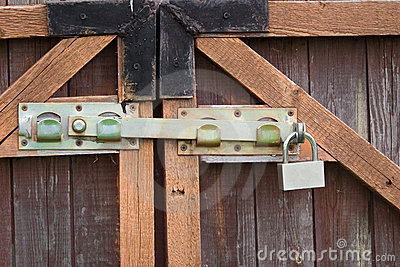 Padlock and a locking bar