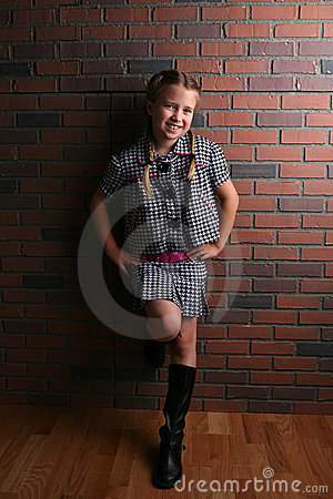 Pretty girl in natural light against brick wall