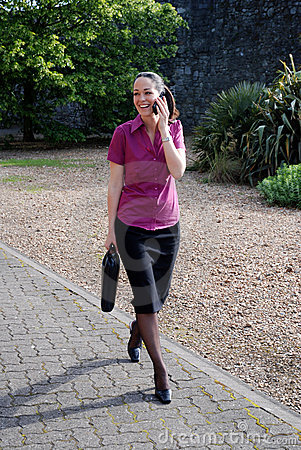 Business woman laughing on phone