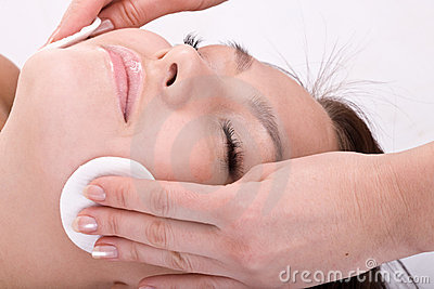 Beautiful woman in spa. Facial massage.