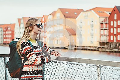 Young woman traveling in Trondheim city Norway vacations weekend Lifestyle fashion outdoor scandinavian houses landmarks architect
