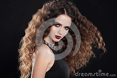Beauty girl hair. Curly hairstyle. brunette girl with healthy lo