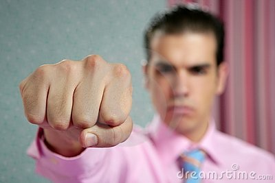 Angry aggresive businessman with fist closeup