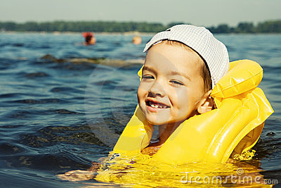 Kid with swiming vest weared