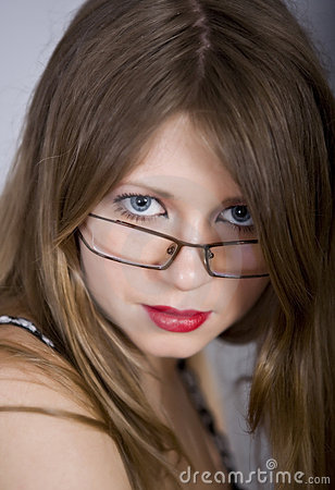 Beautiful girl blonde with blue eyes and glasses