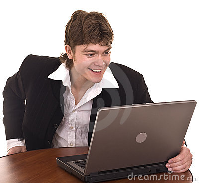 Businessman with laptop in office.