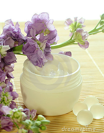 Bowl of cream and flowers.