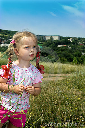 Two little girl in green grass.