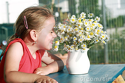 Little girl with chamomile