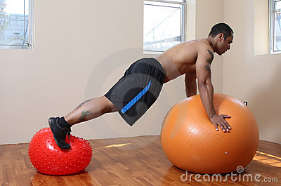 Man with exercise balls