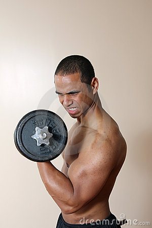 Strong male lifting dumbbell