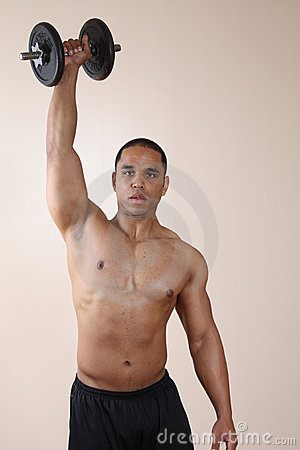 Weight trainer lifting dumbbell with one hand