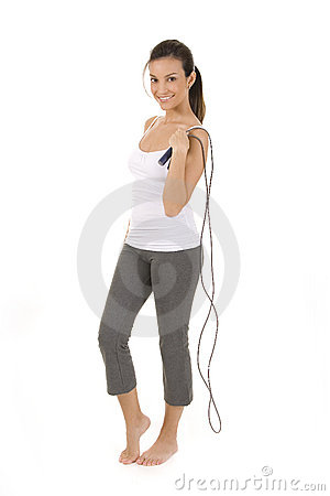 Woman on white holding a jump rope.
