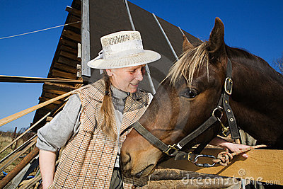 Woman and her horse at farm