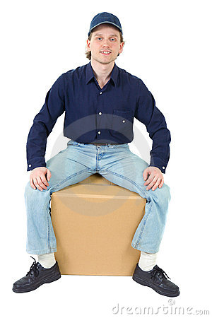 Young man sitting on the cardboard box