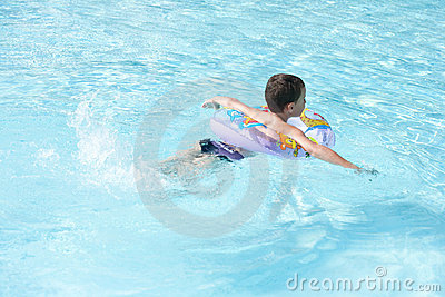 Cute kid swimming in pool