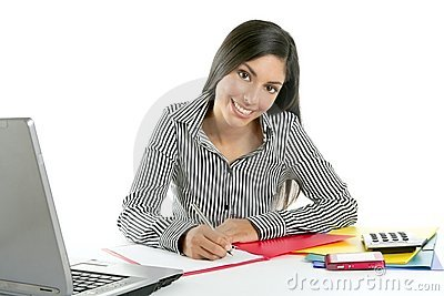 Beautiful secretary businesswoman writing on desk