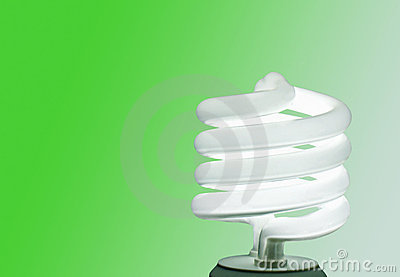 Compact fluorescent lightbulb on green