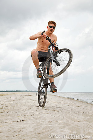 Young man doing wheelie