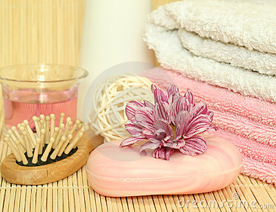 Spa essentials. Towels, soap, flowers.