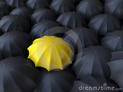 Yellow umbrella surrounded by black umbrellas
