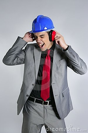 Businessman blue hardhat and safety headphones