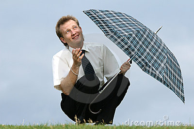 Man with umbrella looking into skies