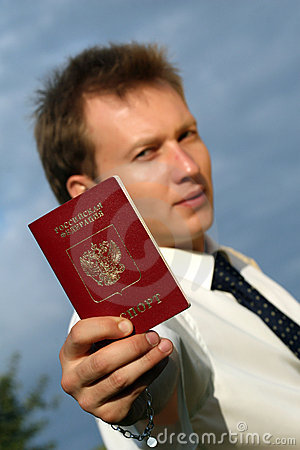 Man holding russian passport