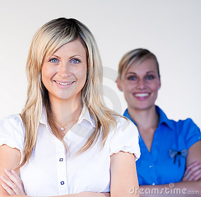 Businesswomen smiling at the camera