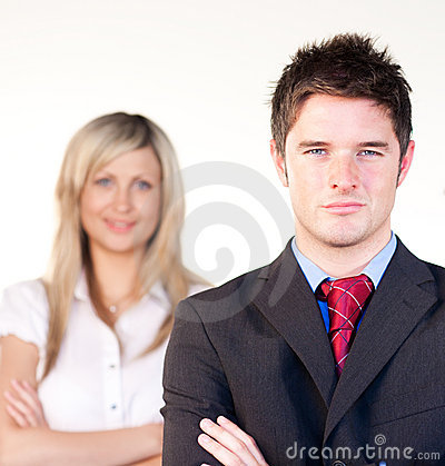 Confident businessman in front of a businesswoman