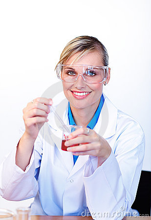 Smiling female scientist examining a test-tube