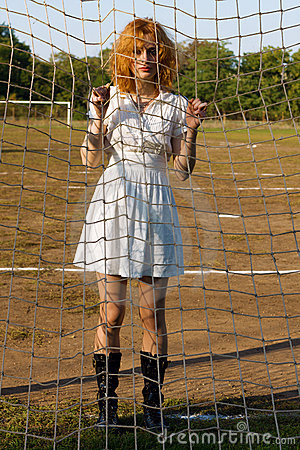 Sexy young woman at soccer gates