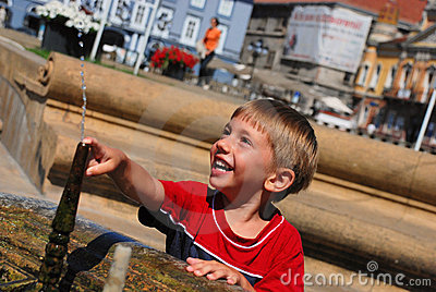Little boy playing with water