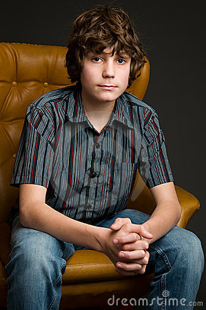 Teen boy sitting in a chair