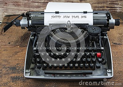 Old typewriter from seventies with paper and copy space.Happy new year 2018.