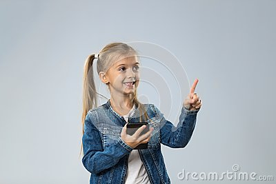 Little Teenage Girl Using Cell Smart Phone, Small Happy Smiling Child Point Finder To Copy Space